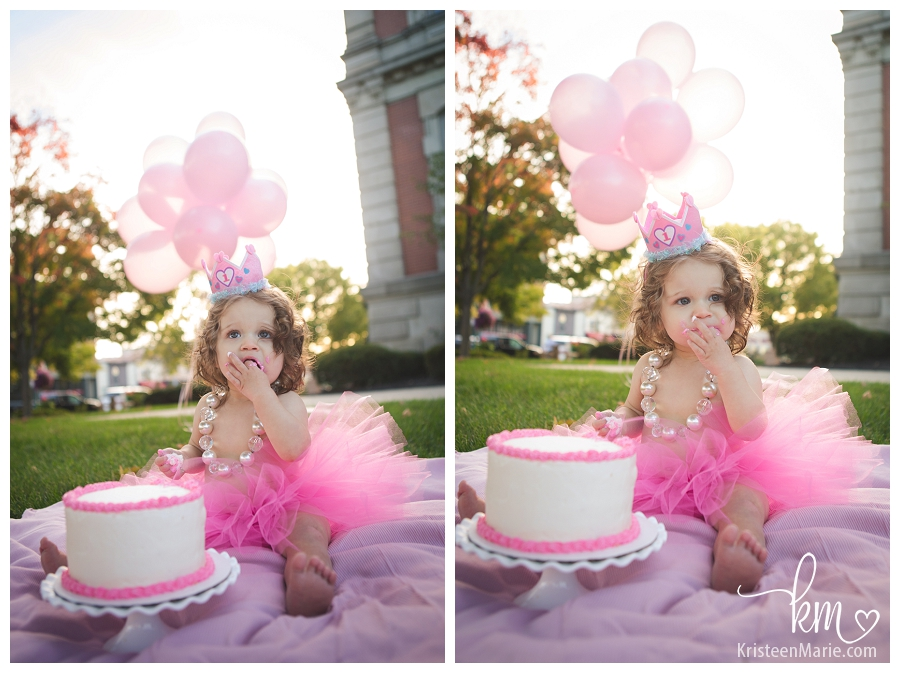 eating cake at first birthday