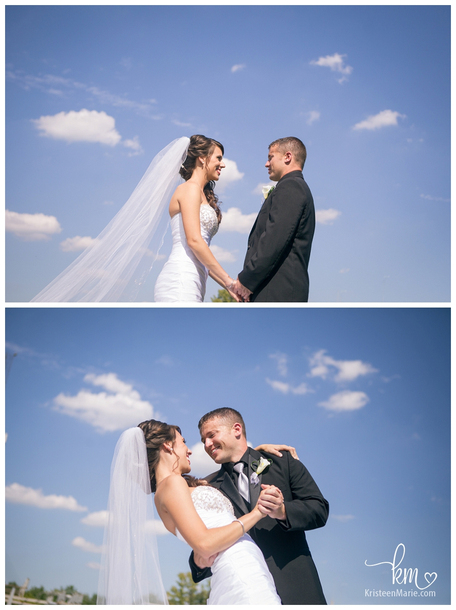 bride and groom on blue sky day