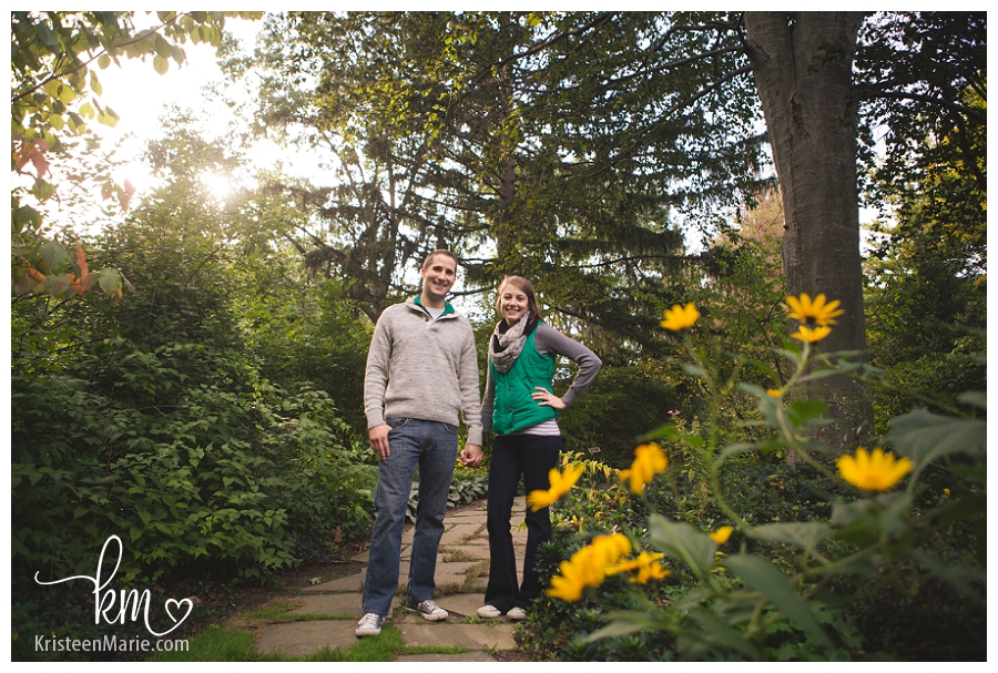 yellow flowers and an engaged couple