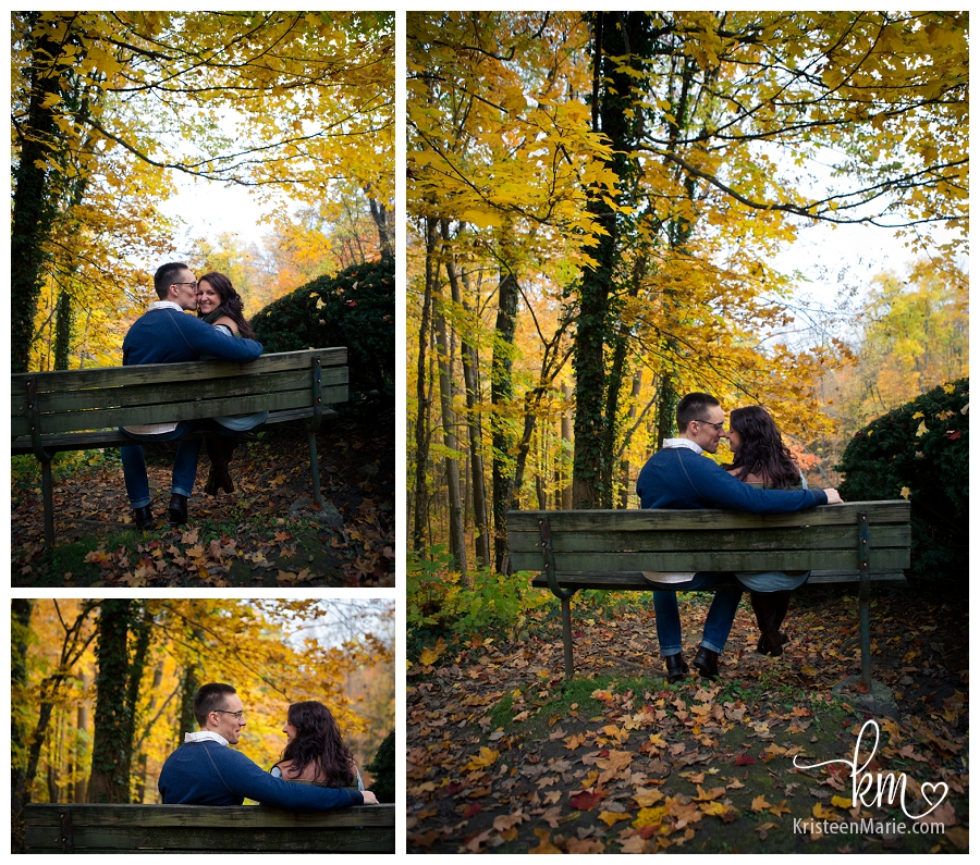 sitting on a bench with the Fall colors in the background