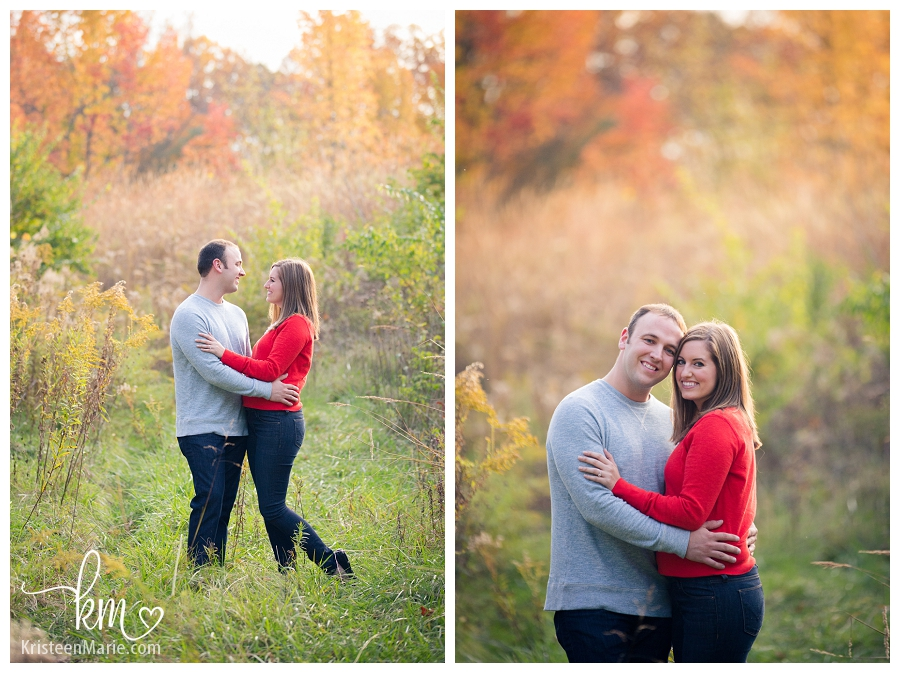 couple surrounded by stunning Fall trees