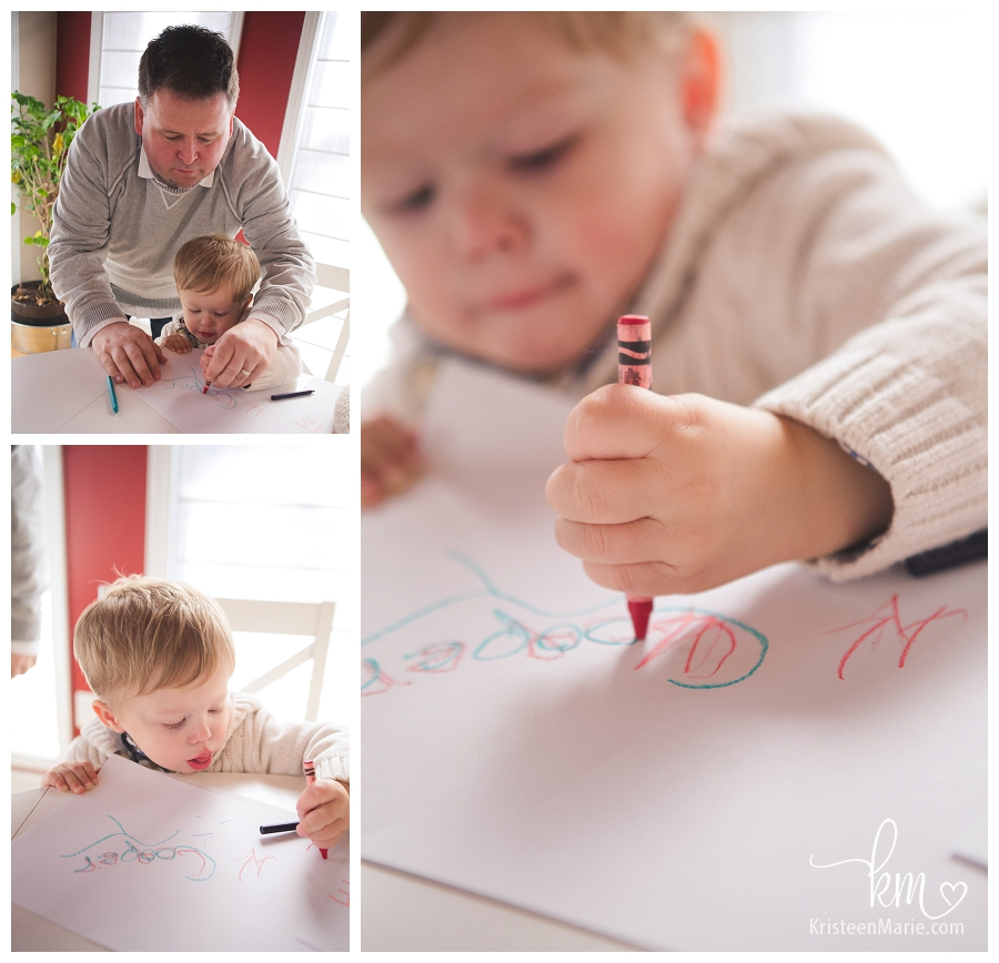 dad helping his son write his name