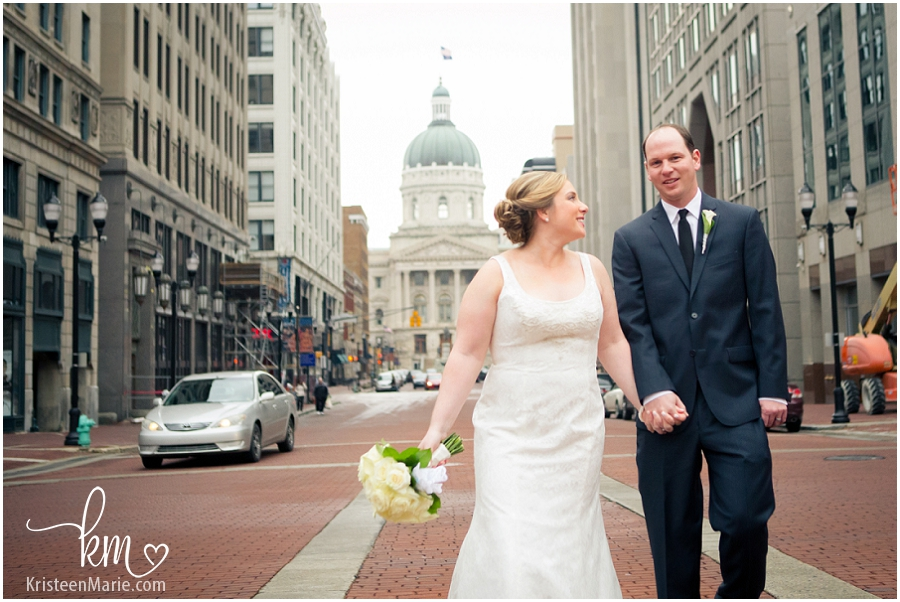 Couple with the Indianapolis state house behind them