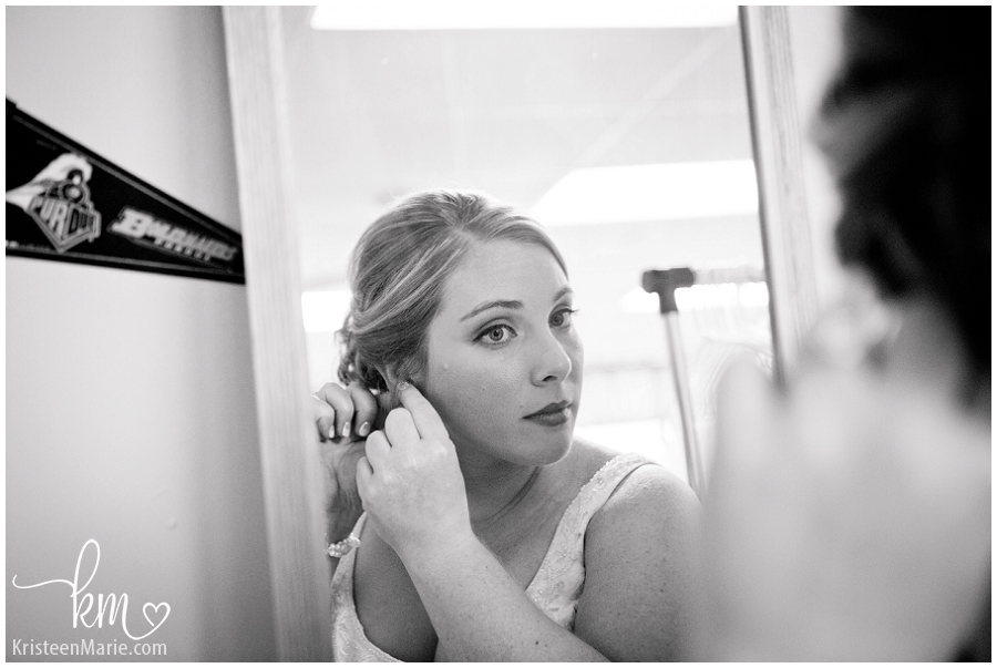bride putting on earnings