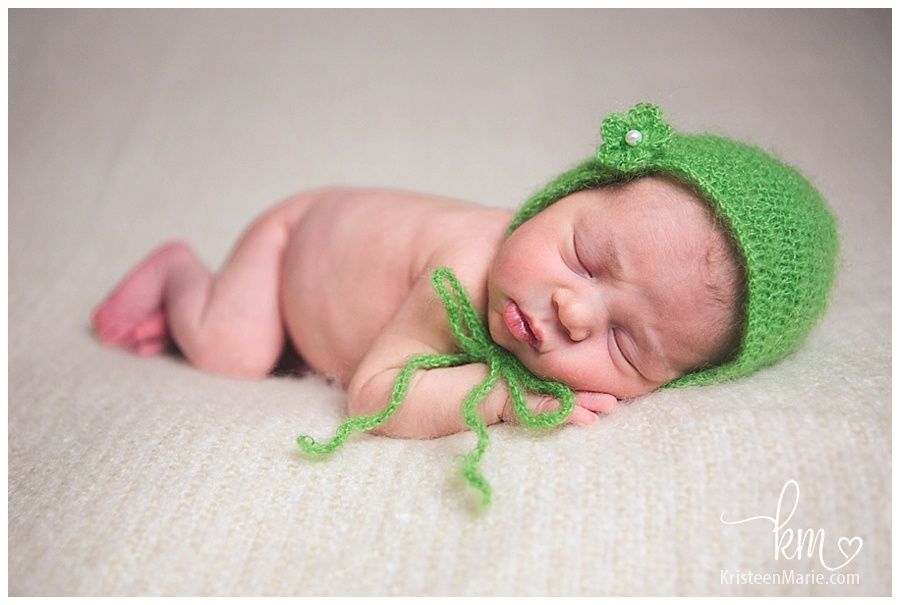 Newborn girl with green bonnet