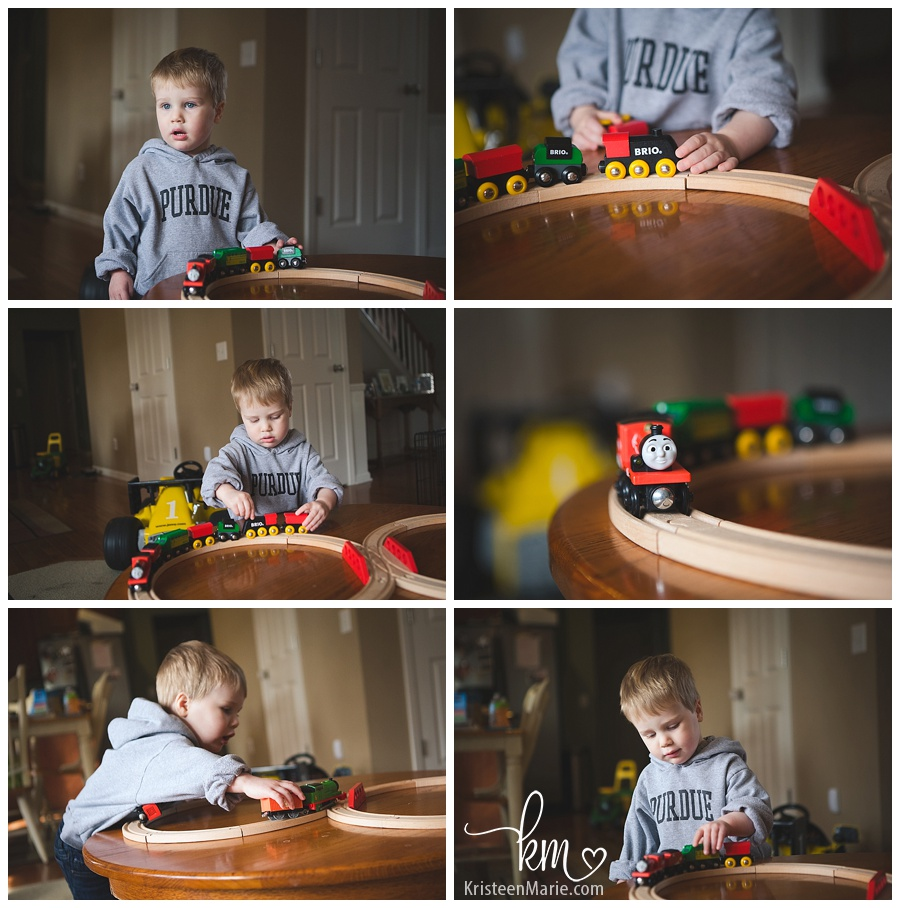 little boy playing with his train