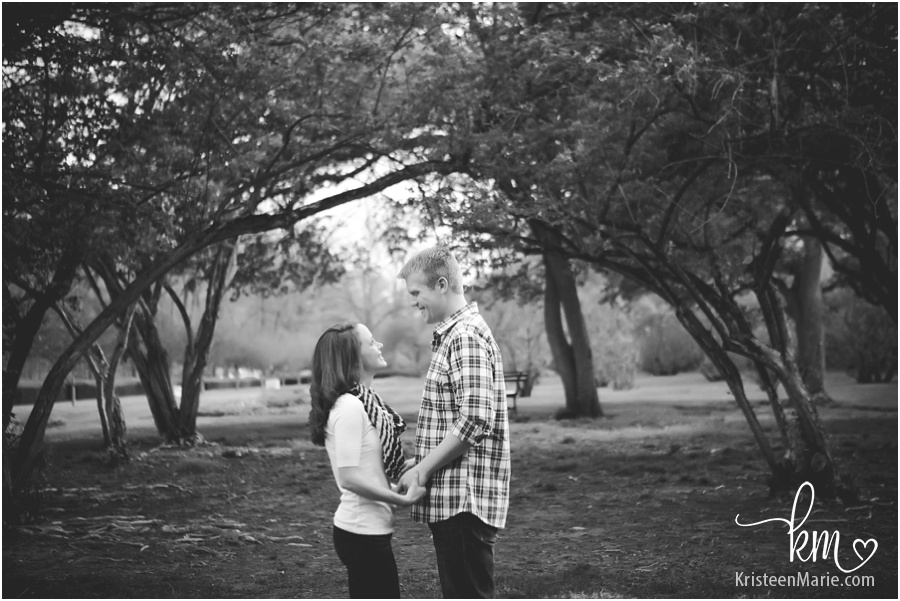 black and white engagement picture at park