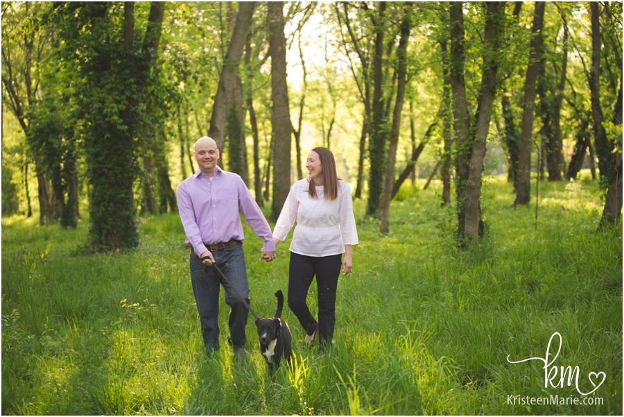 Indianapolis engagement picture with puppy at 100 Acre Woods