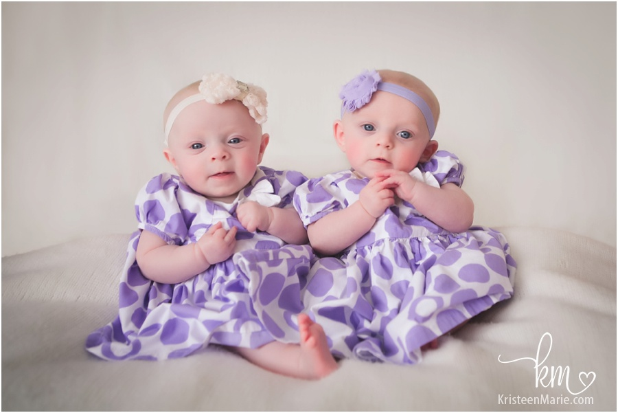 3 Month old twin girls in purple dresses