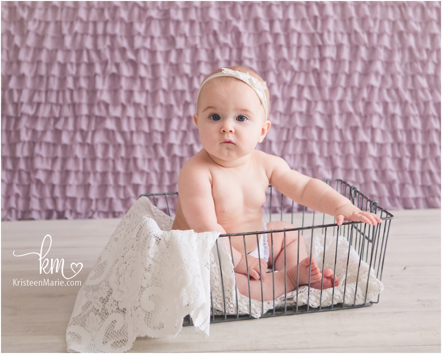 baby picture with purple and lace