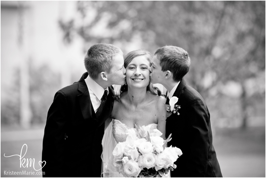 ring bearers kissing bride