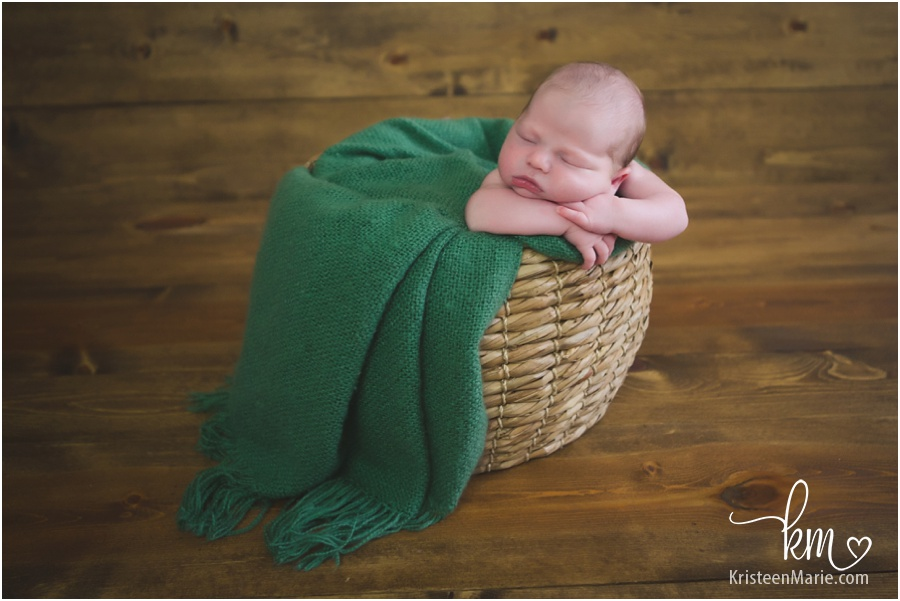 baby in a basket - green and brown