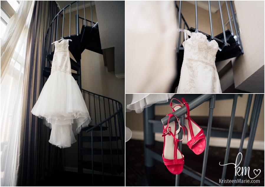 Wedding dress hanging in Omni Severin Hotel room