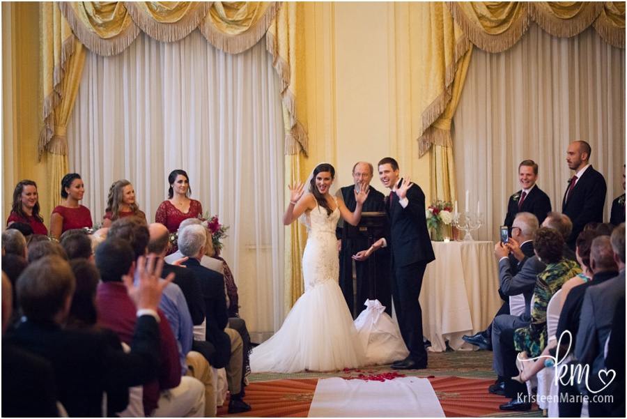 bride and groom showing emotion during wedding ceremony