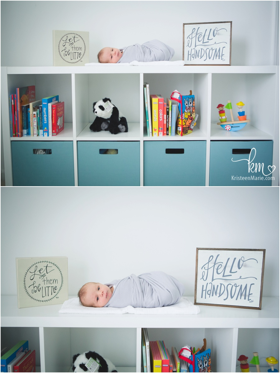 baby in nursery with cute signs