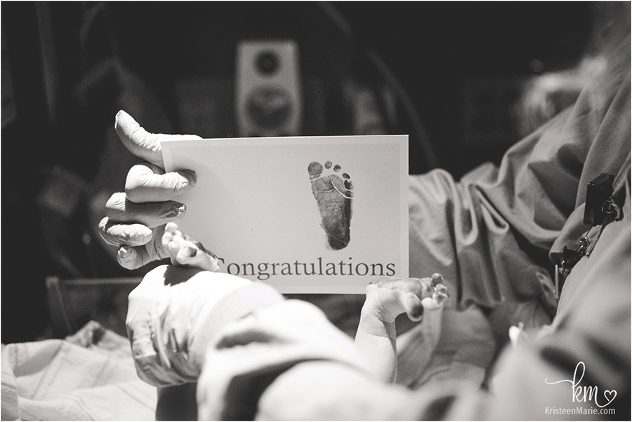 newborn foot prints -  birth photography
