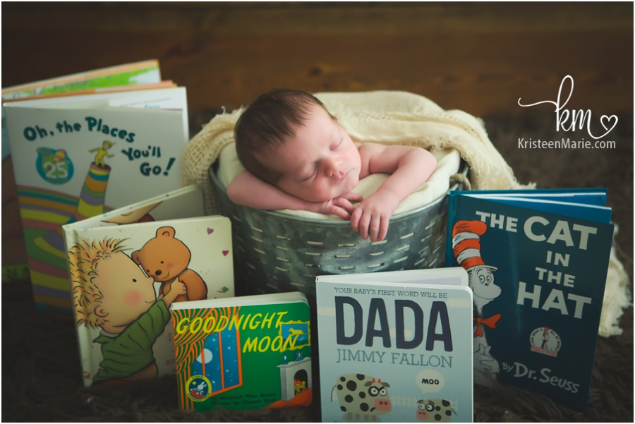 newborn baby with baby books