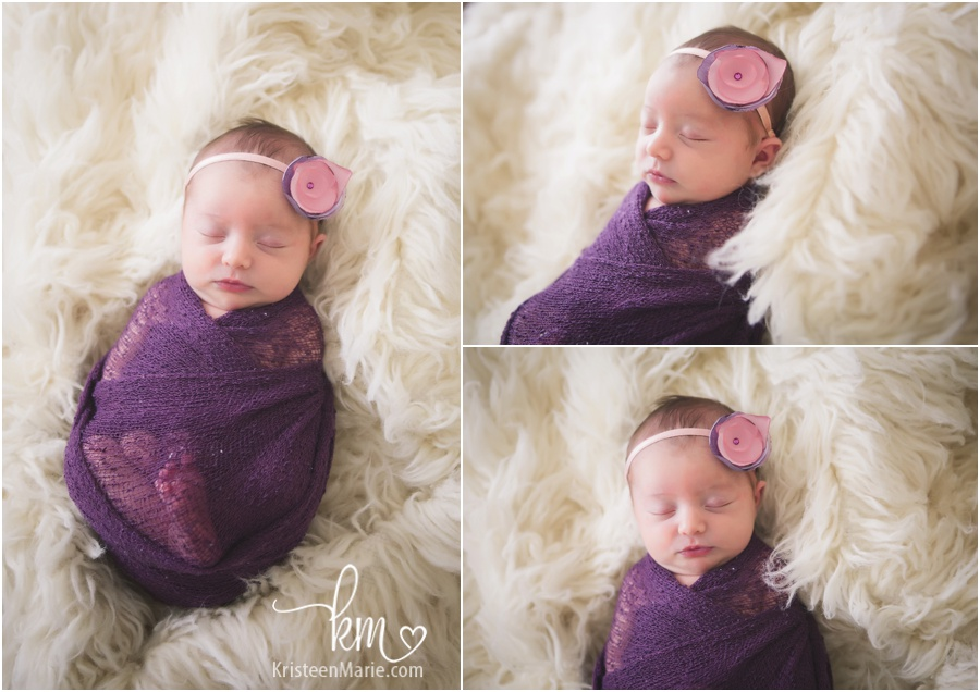 sleeping newborn girl in purple and pink