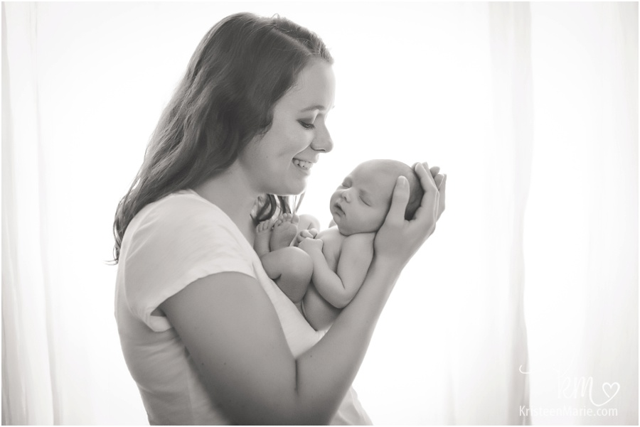 mom and newborn baby in black and white