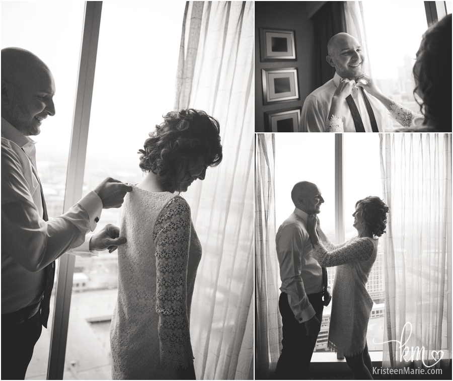 bride and groom helping eachother get ready