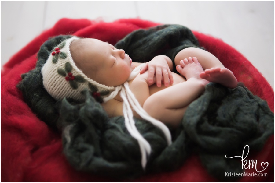holiday set-up for newborn baby - green and red Christmas picture with baby