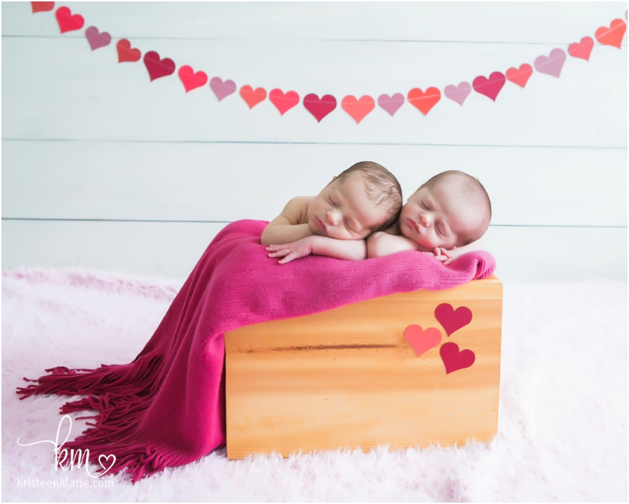 Valentines Day themed newborn photography - hearts, pink, and love