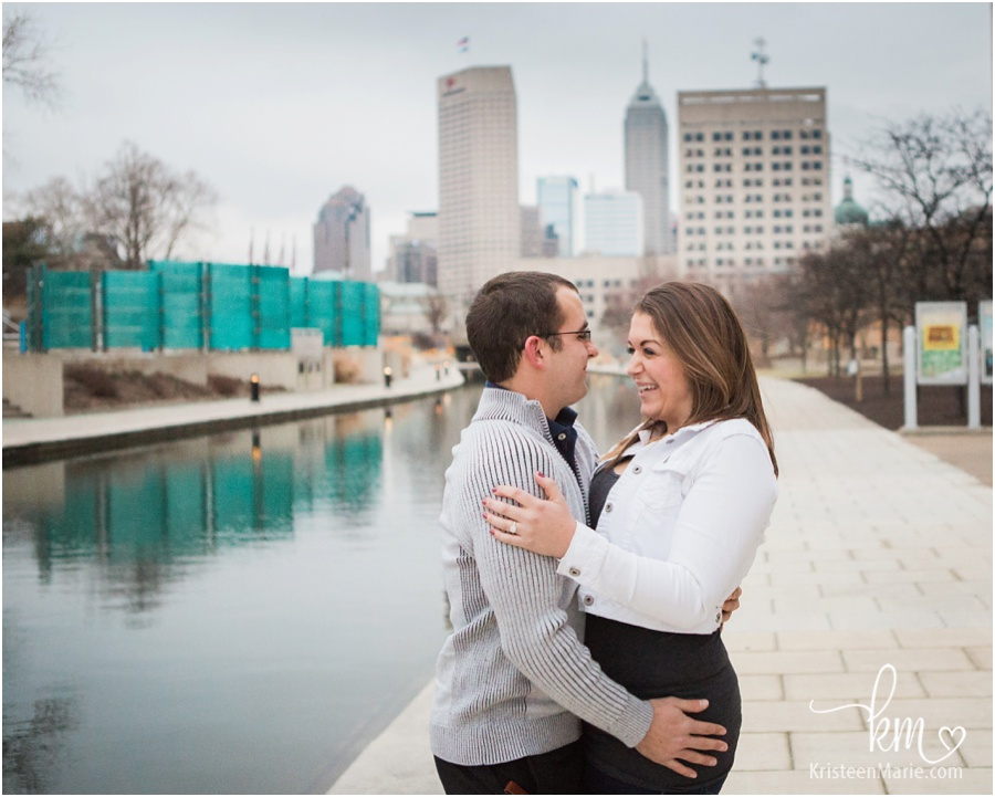 couple laughing after proposal in downtown Indianapolis on canal