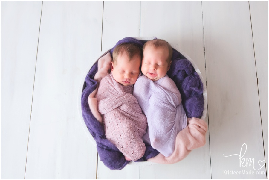 Sleeping newborn baby girls - purple and blush