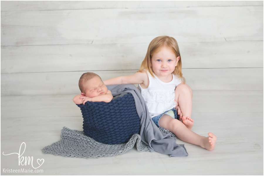 sibling picture - newborn baby and older sibling - sibling newborn pose