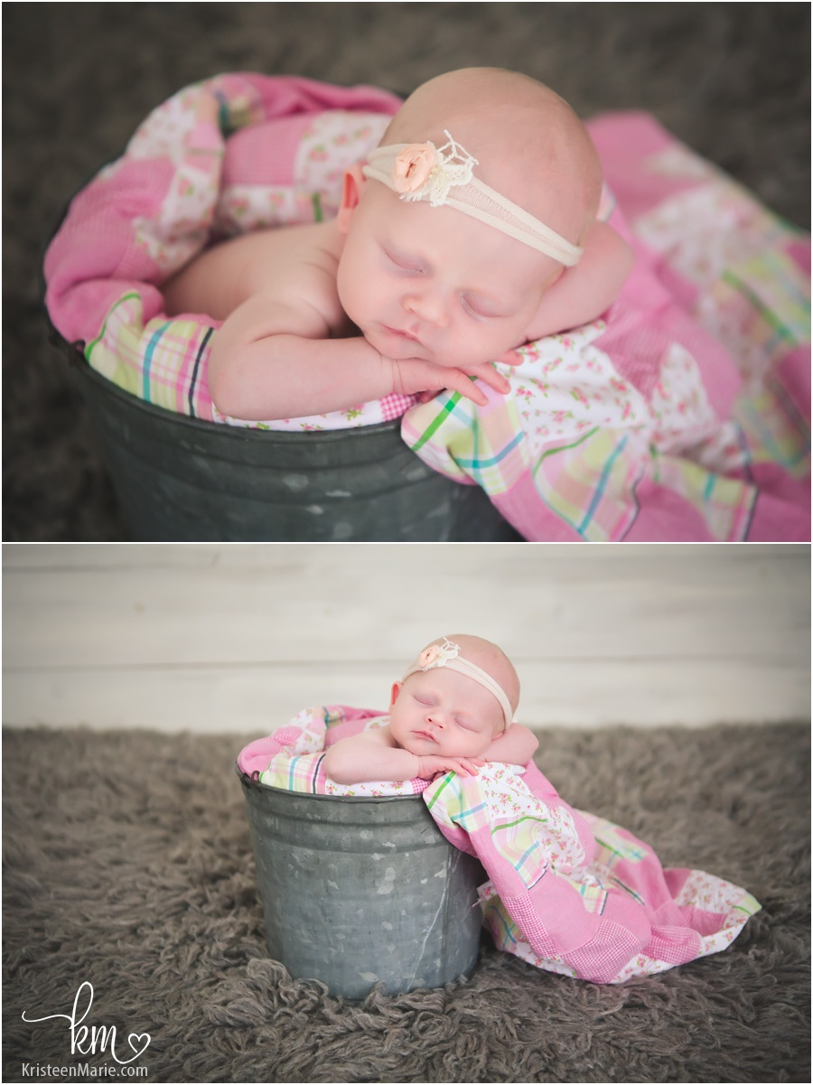 sleeping newborn girl in bucket - pink and grey