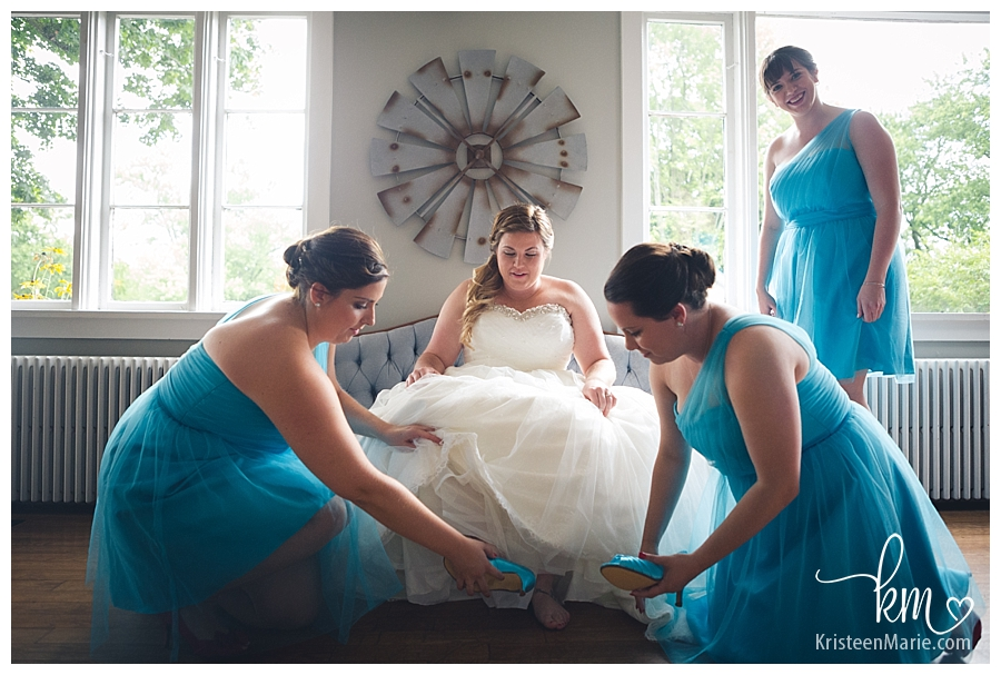Putting on shoes on wedding day