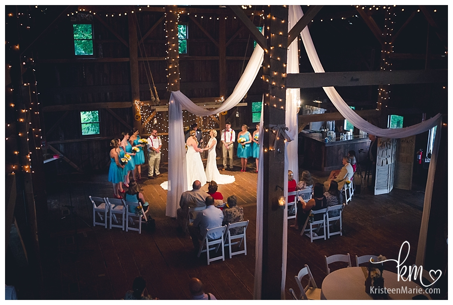 Wedding ceremony inside barn at Mustart Seed Gardens