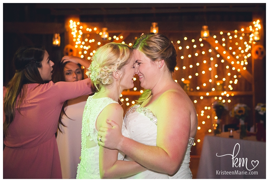 two brides on dance floor
