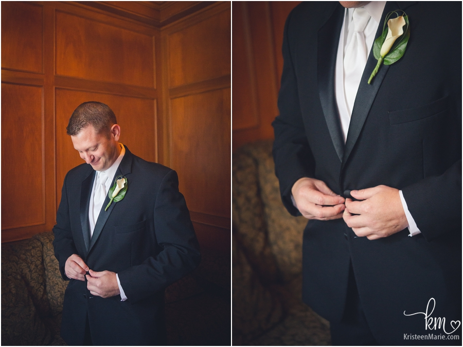 the groom getting dressed for his wedding day