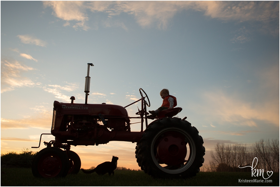 sunset silhouette with boy on tractor - beautiful!!