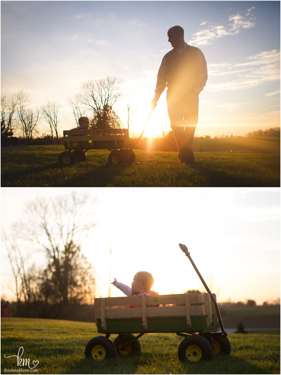 beautiful outdoor sunset pictures with boy in waggon