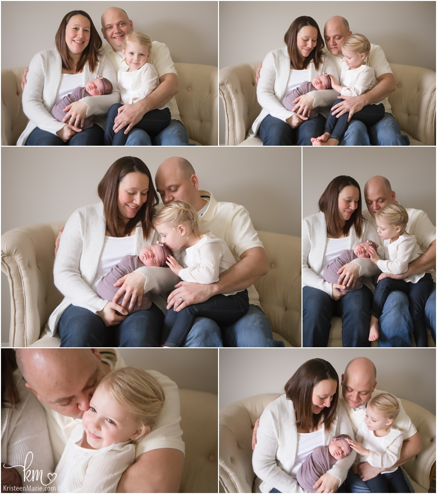 family on a couch with newborn baby girl