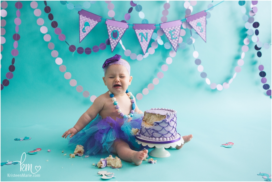 baby isn't happy after cake smash session