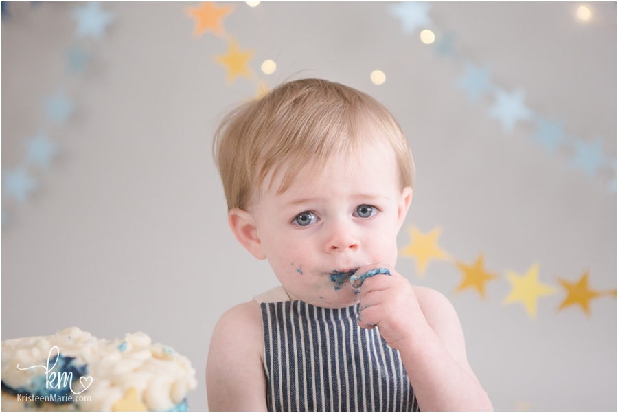 boy eating birthday cake