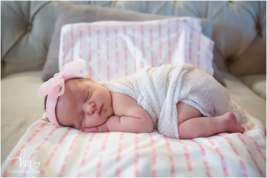 sleeping newborn girl on blanket