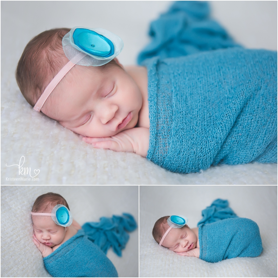 Sleeping newborn girl in teal