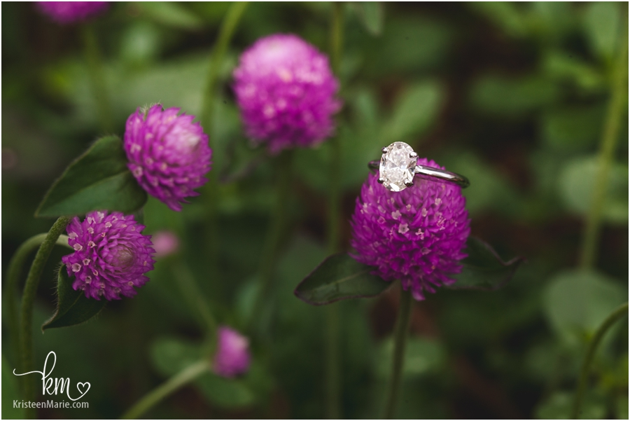 engagement ring and purple flowers