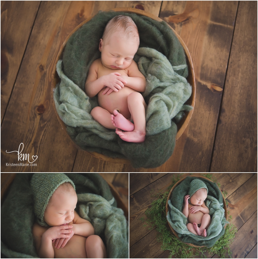 baby boy in green on rustic wood