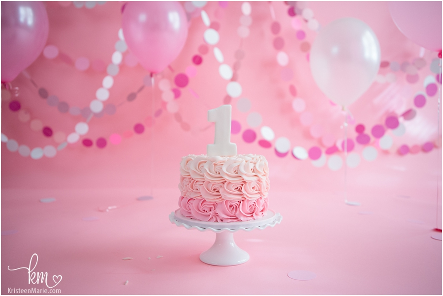 pink cake smash setup - cake, baloons, and backdrop all pink