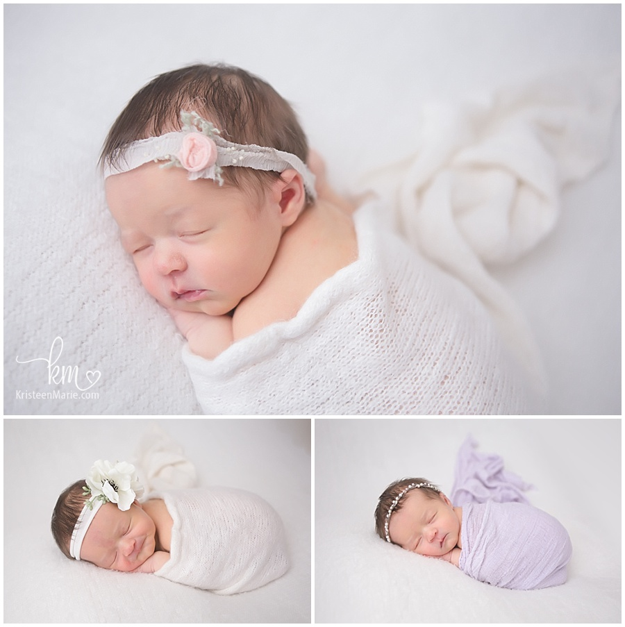 sleeping newborn baby girl in white and purple