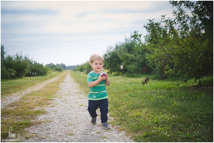 running happy in the apple orchard