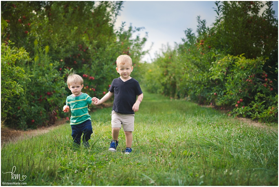 boys holding hands in the orchard