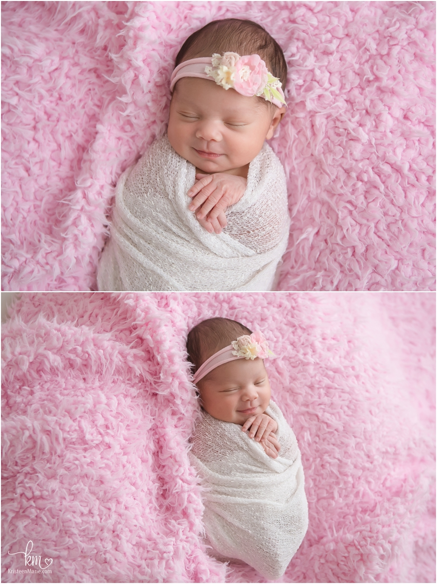 sleeping newborn girl - pink and smiling
