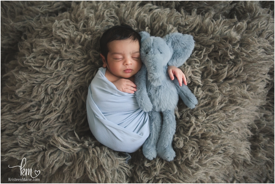newborn baby with stuffed elephant