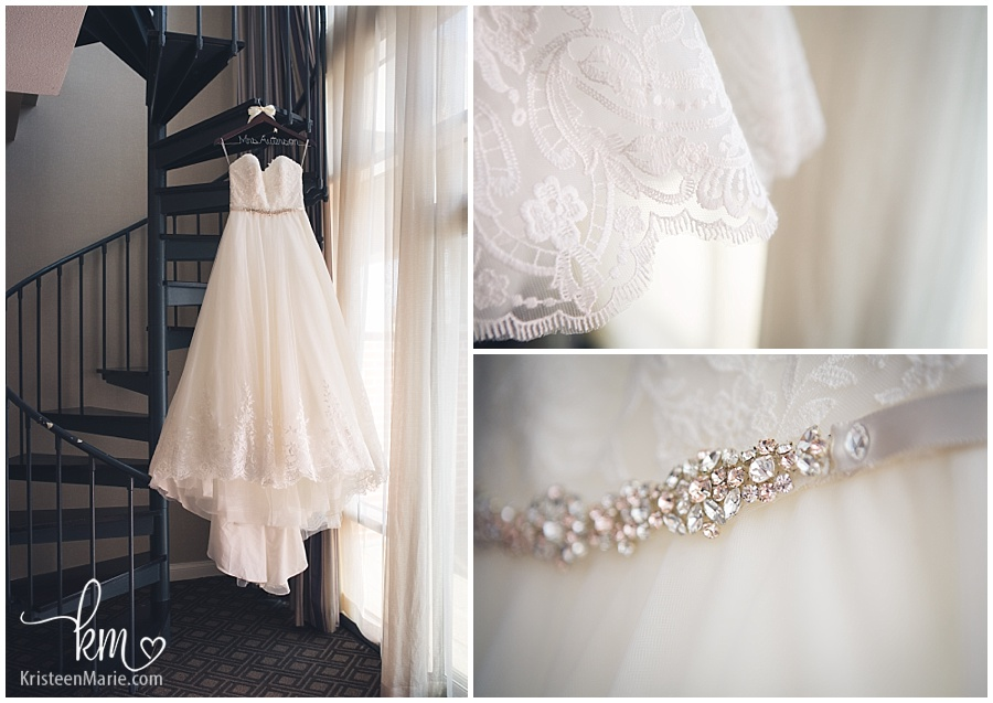 the wedding dress on staircase at Omni Hotel